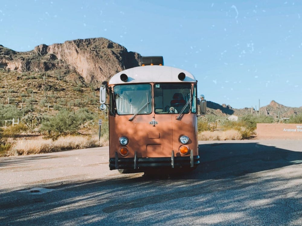 A couple and their dog live full-time in a 298-square-foot bus they transformed into their mid-century modern dream home on wheels